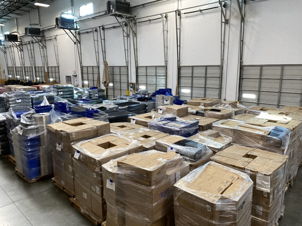 warehouse with palettes of wastebaskets