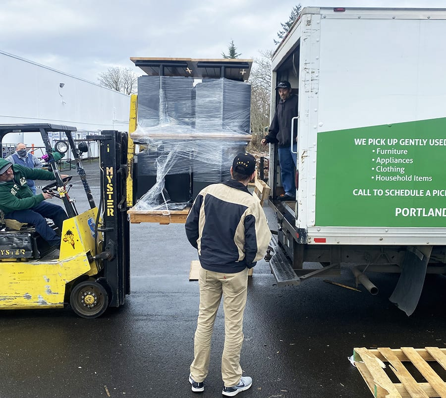 unloading furniture at charity
